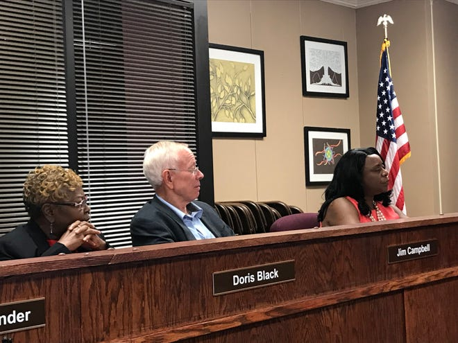 Doris Black, newly sworn in, and existing board members Jim Campbell and Janice Hampton listen during the JMCSS meeting on Sept. 13.