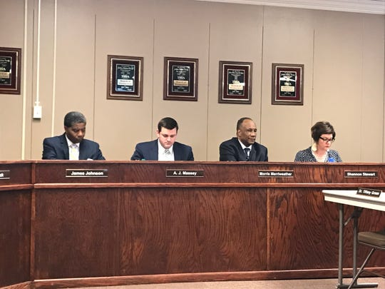 James Johnson, A.J. Massey, Morris Merriweather and Shannon Stewart sit for their first board meeting on Sept. 13. Doris Black, the fifth new board member, is seated on the opposite side due to alphabetical order.