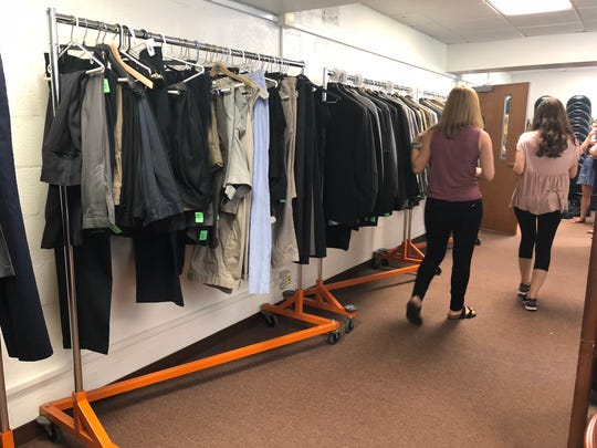Emma Heins and Sophia Rhoades shop at the Smokey's Closet on UTK's campus. The closet provides free professional attire to students.