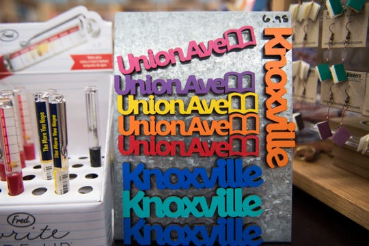 Magnets hang in Union Ave. Books, in downtown Knoxville Friday, Sept. 14, 2018. The store is co-owned by Flossie McNabb and her daughter Bunnie Presswood, and is expanding into space next door.