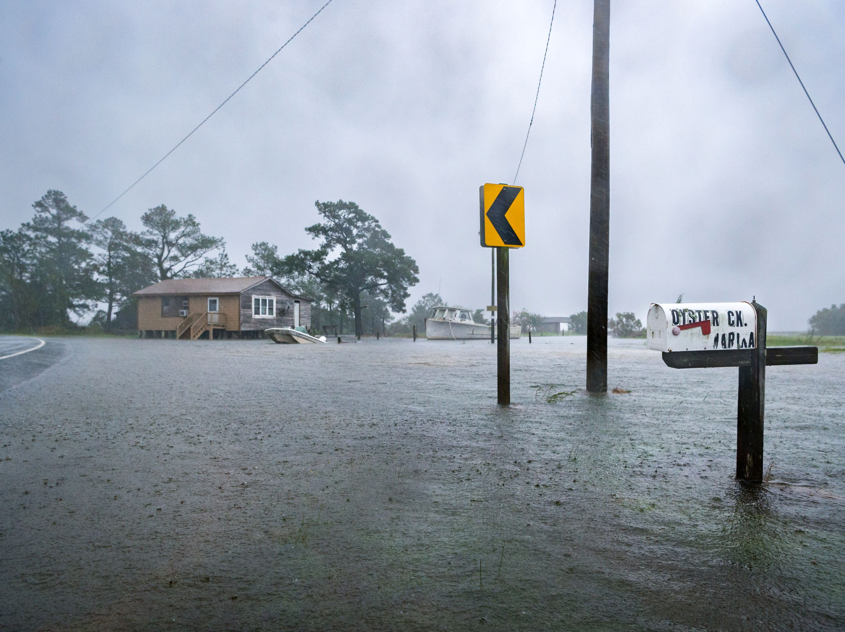 Sept 13, 2018; Swan Quarter, NC, USA; A mailbox on Oyster Creek Street in Swan Quarter, N.C sits partially submerged as heavy rain and wind increases with Hurricane Florence moving closer to the coastline.