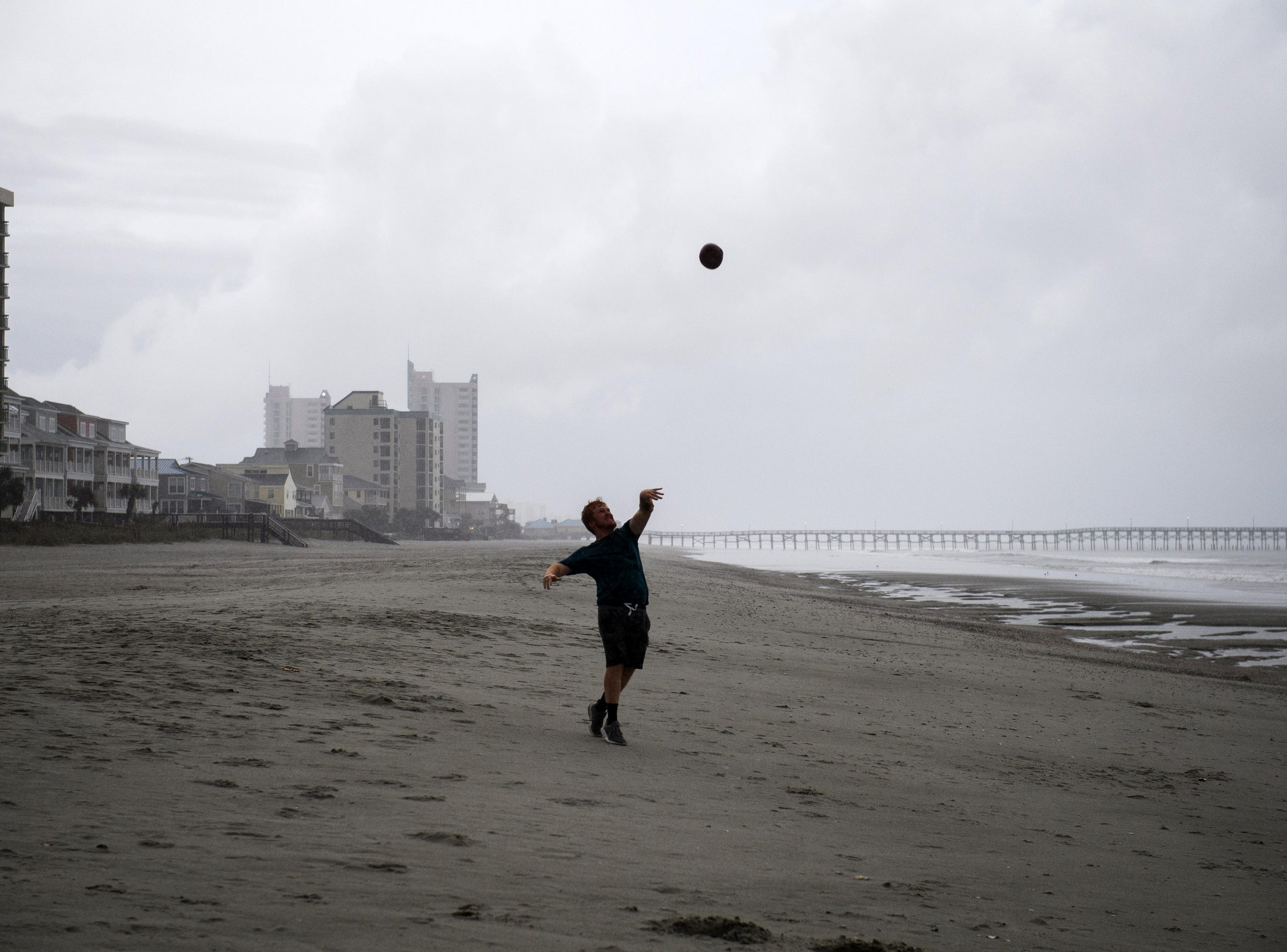 Sept 13, 2018, North Myrtle Beach, SC, USA; Noah Peele, 20, plays catch at Cherry Grove Beach in North Myrtle Beach as the first rain from a stray outer band of Hurricane Florence hits the area.