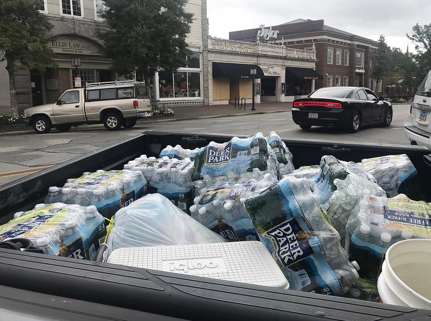 September 13, 2018; Edenton, NC, USA; A pickup truck with cases of water in downtown Edenton.