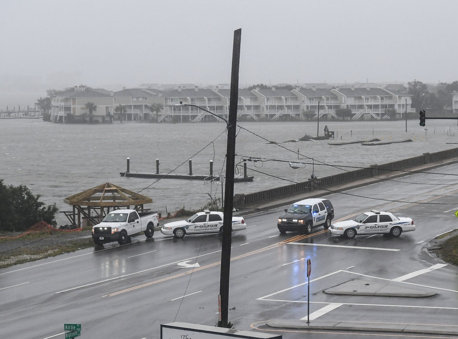 September 14, 2018; Wilmington, NC, USA; Law enforcement block traffic into Wrightsville Beach from Wilmington, North Carolina on Friday as Hurricane Florence passes through on Friday, September 14, 2018.