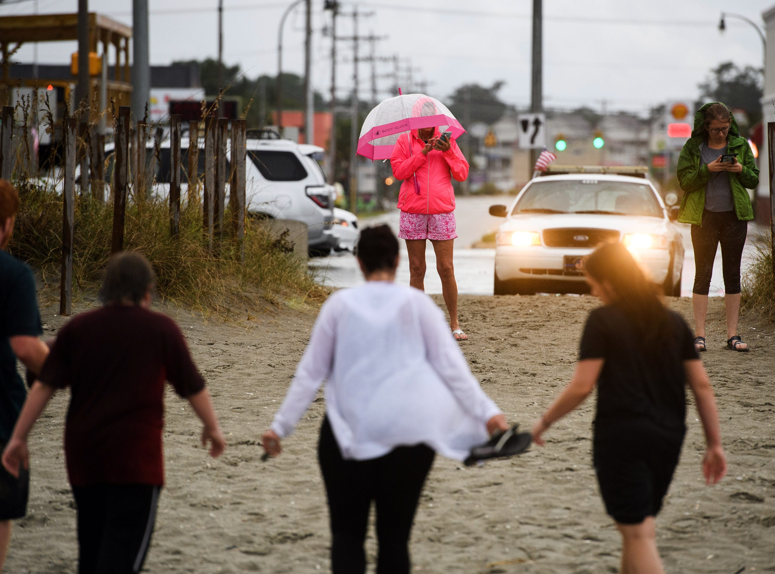 Sept 13, 2018, North Myrtle Beach, SC, Beachgoers leave after being informed of a curfew due to Hurricane Florence.