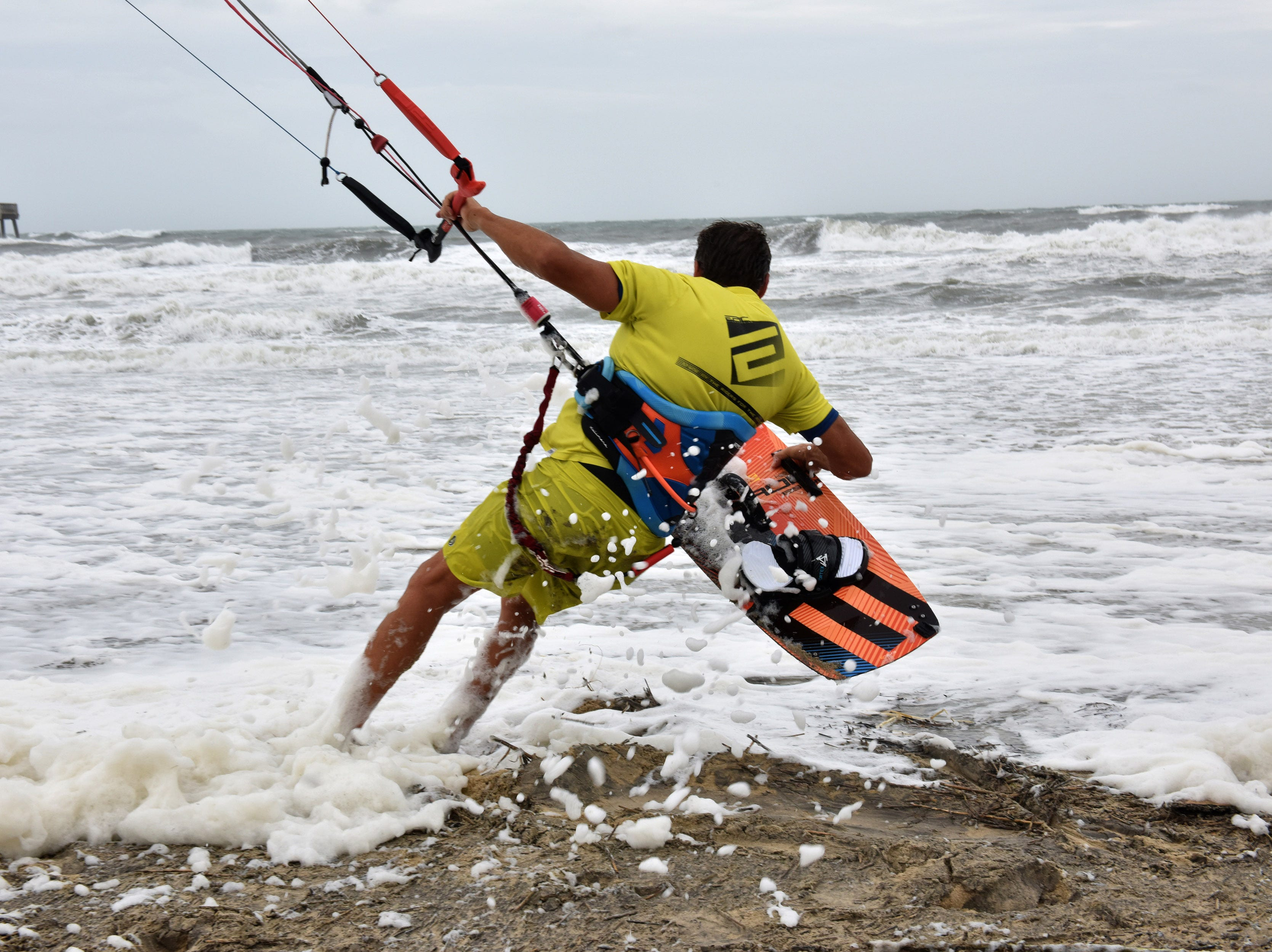 September 14, 2018; Nags Head, NC, USA; Dimitri Maramebnides heads back into the Atlantic Ocean to kite surf in Nags Head, N.C. in the Outer Banks on Friday morning September 14, 2018.