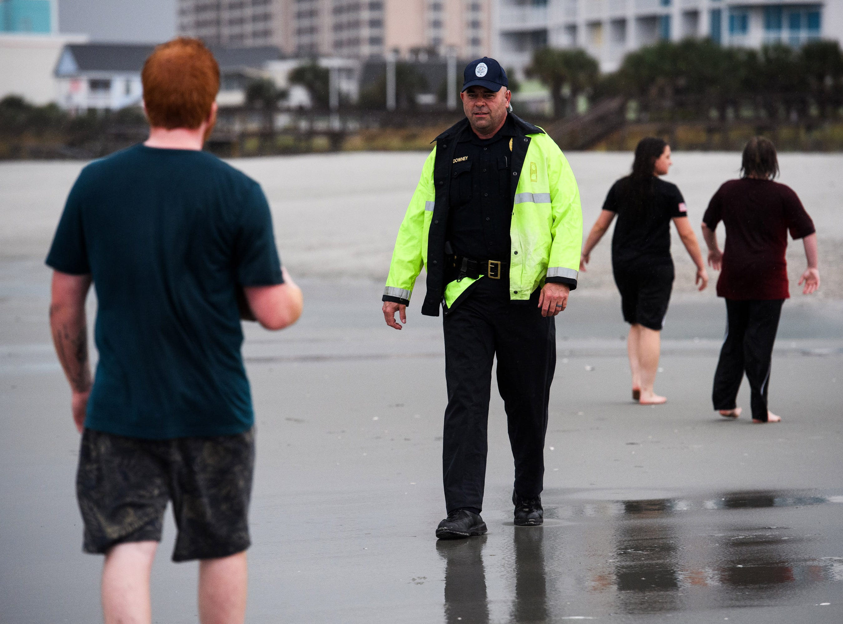 Sept 13, 2018, North Myrtle Beach, SC, A North Myrtle Beach public safety officer informs beachgoers of the 7 p.m. curfew due to Hurricane Florence.