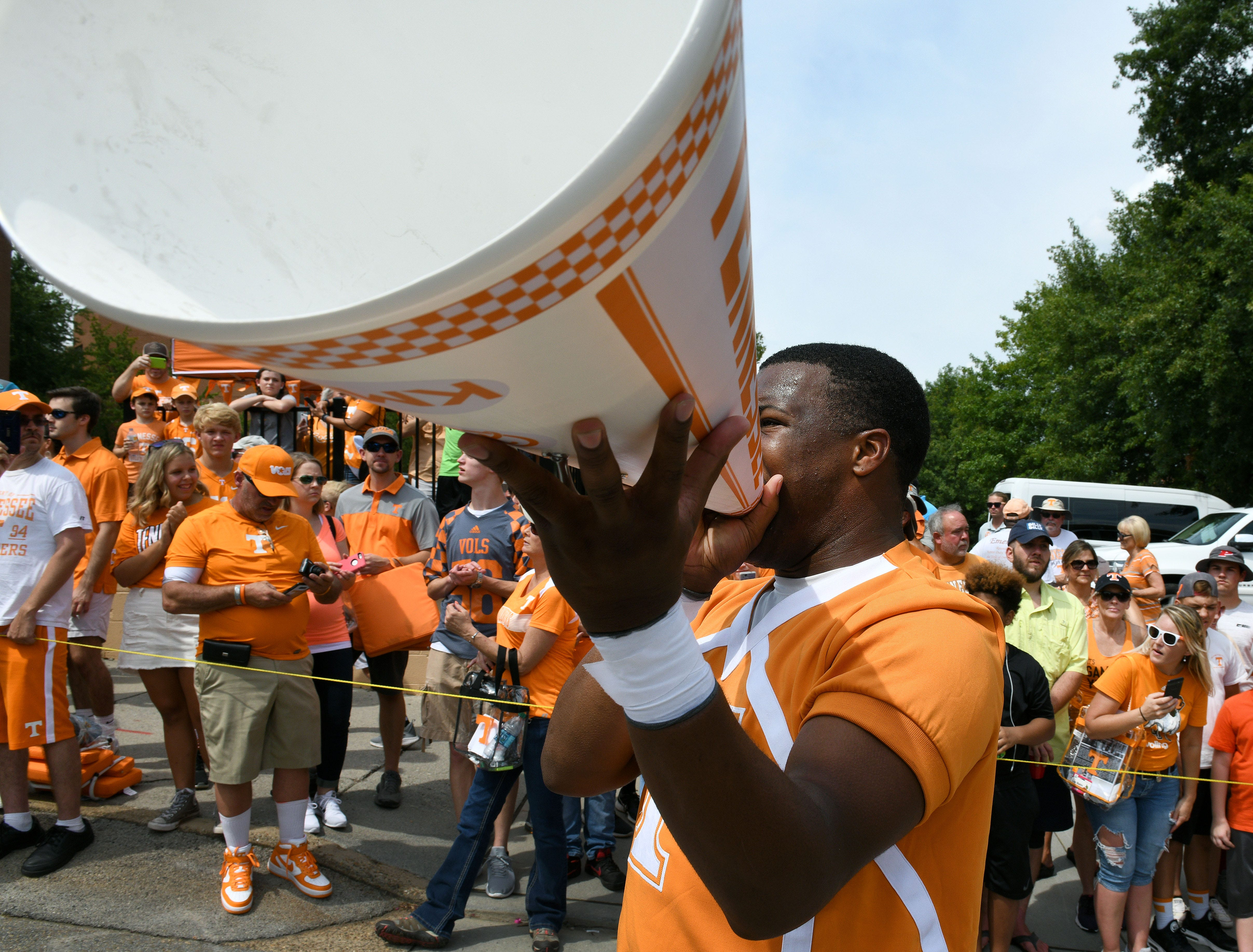 Tennessee cheerleader Kahlil Bostick preparing fans for the Vol Walk  before the East Tennessee State game Saturday, September 8, 2018 at Neyland Stadium in Knoxville, Tenn.