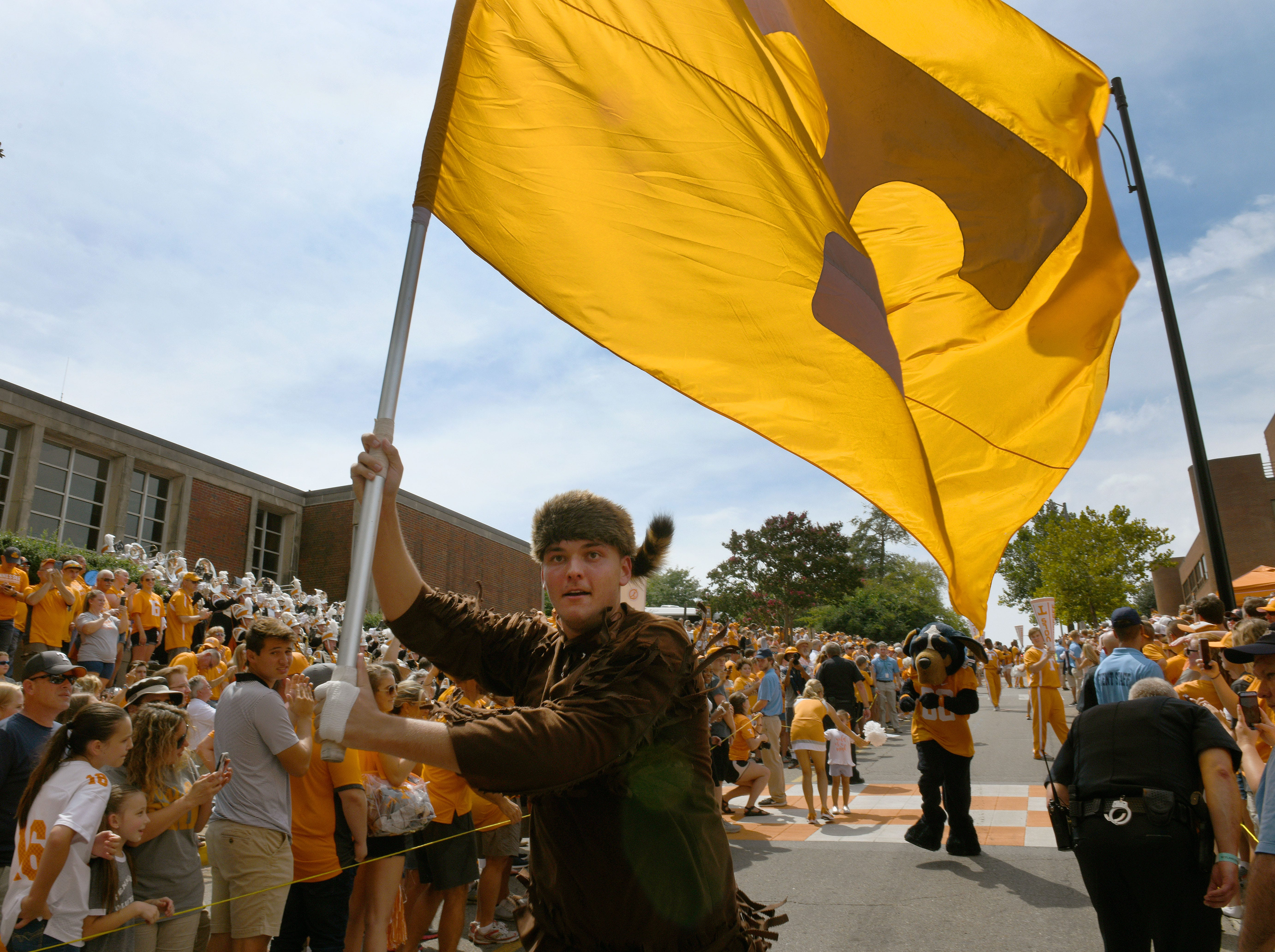 The Volunteer Cainan Phillips carries the flag during pre-game activities before the game against East Tennessee State Saturday, September 8, 2018 at Neyland Stadium in Knoxville, Tenn.