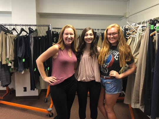 UTK students Emma Heins, Sophia Rhoades and Hannah James shopped at the Smokey's closet on Friday afternoon. The closet provides free professional clothing for UTK students and is open twice a week, from noon to 4 p.m. on Tuesdays and Fridays.