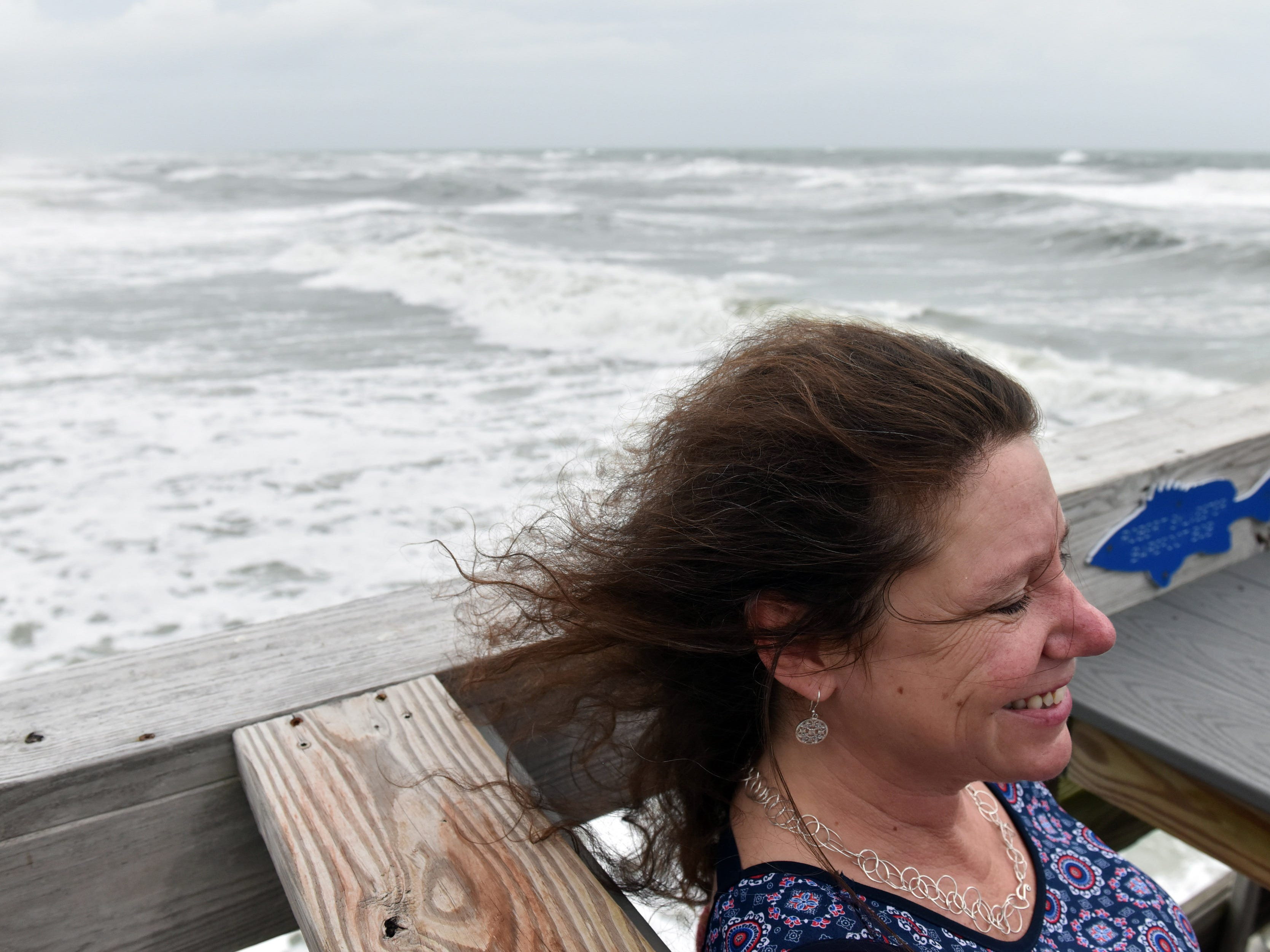 September 14, 2018; Outer Banks, NC, USA; Melody Glidewell, of Kill Devil Hills, N.C., watches the waves crash on shore from the Avalon Fishing Pier in the Outer banks on Friday morning September 14, 2018.