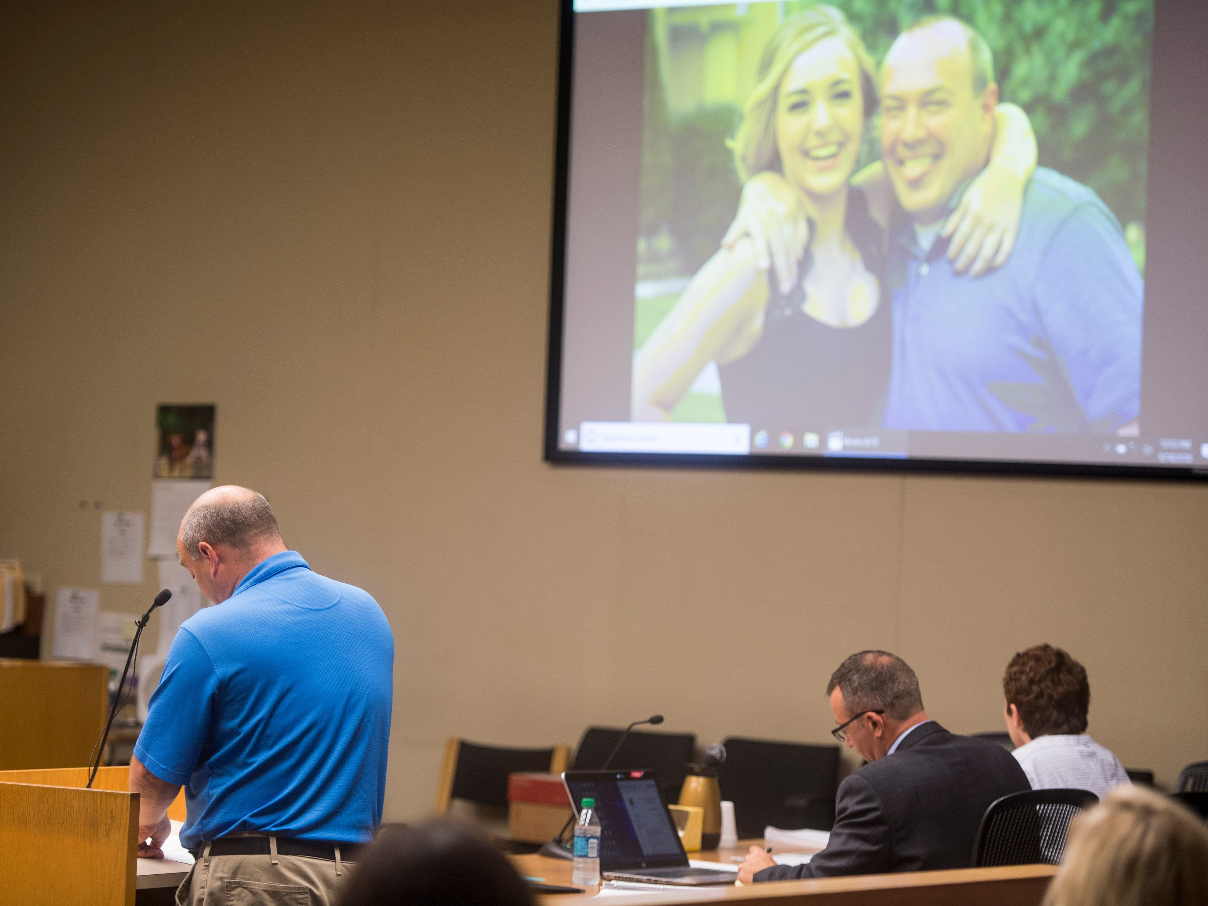 Photos of Emma Jane Walker are shown on a screen as Walker's father Mark Walker gives a victim impact statement at William Riley Gaul's sentencing in Knox County Criminal Court on Friday, September 14, 2018.