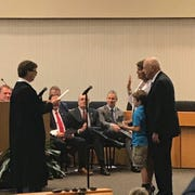 Terry Hill with grandson Bryson Cody is being sworn in to her second 4-year term on the Knox County School Board at the Knoxville City-County Bldg. Friday, Aug. 31.