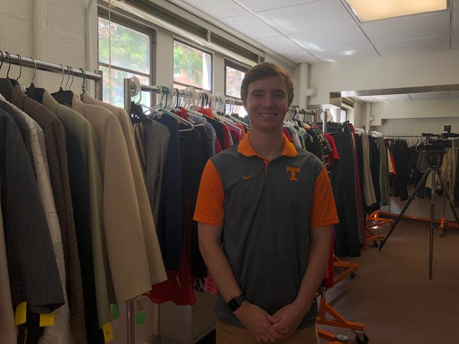 Noah Dunlap, a junior at UTK, helps run Smokey's closet. Dunlap said they are currently looking for donations of pants hangers, men's dress shirts in smaller sizes and men's shoes and ties.