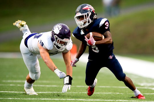 South-Doyle's Ezra Young (3)evades Sevier County's Garrett Adams (19) during a football game between South-Doyle and Sevier County at South-Doyle High School in Knoxville, Tennessee on Thursday, September 13, 2018.