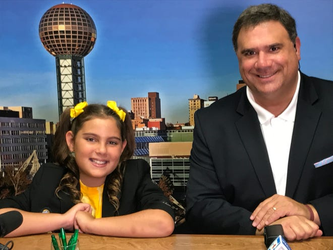Fifth-grader Madalynne Mathis co-hosts the morning news with Russell Biven, Sept. 5, 2018.