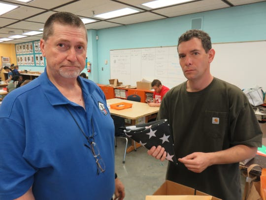 Bearden Middle School staff members Stephen Shedden, left, and Mike Weininger have coordinated a 9/11 program at the school for several years.