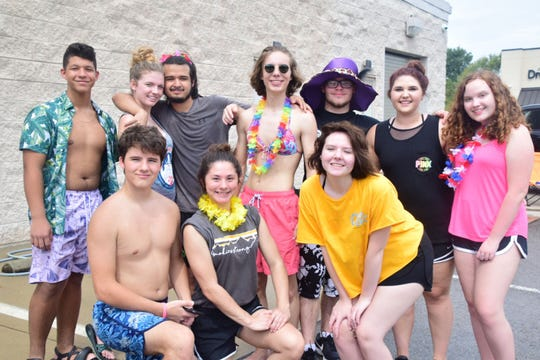 """Members of the Karns High Choir put on a car wash and bake sale at Advance Auto Parts on Saturday, Sept. 8, to raise money for this year's musical theater production of """"Once Upon a Mattress."""" Front left are Sam Pinkston, 15, Madison Maples, 17, Alyssa Olds, 15; (back) Xavier Parez, 15, Abby Wolkotte, 17, Carlos Artiz, 17, Lee Pinkston, 17, Cole Dement, 19, Sydni Stinnett, 17, and Emma Greene, 16."""