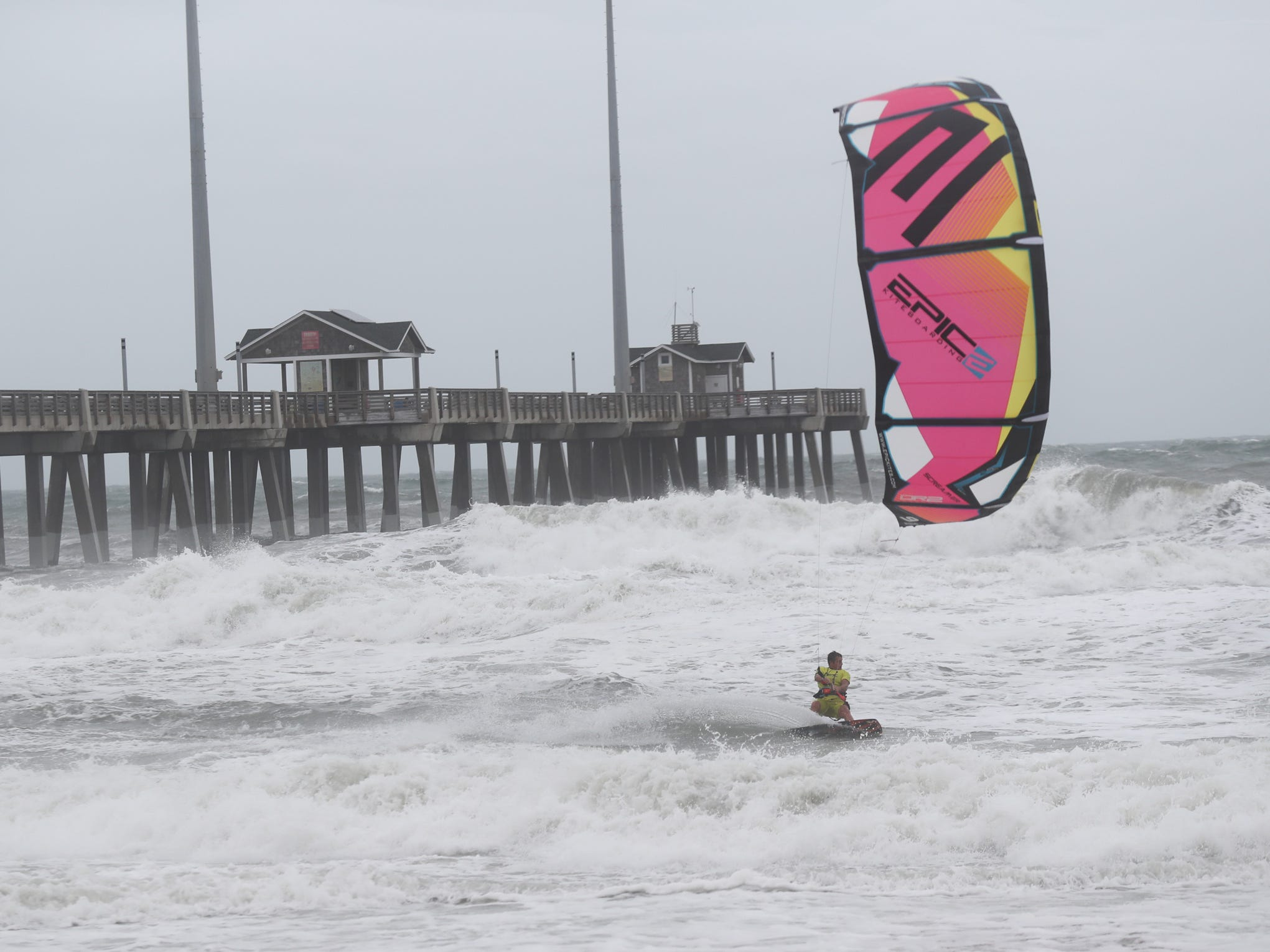 September 14, 2018; Nags Head, NC, USA; Kiteboarder Dimitri Maramenides surfs the waters off Jennette's Pier in Nags Head, North Carolina on Friday, September 14, 2018.