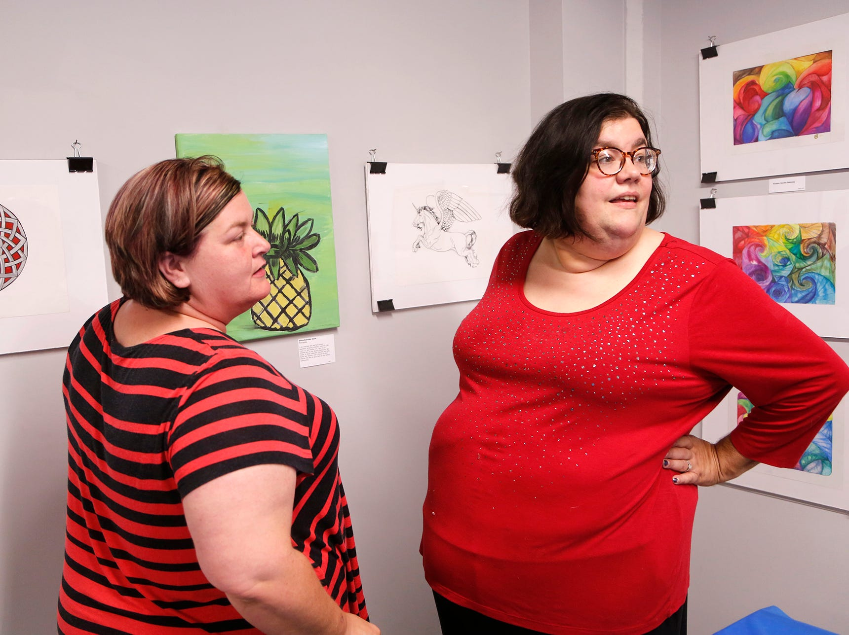 Tiffany Kendall, left, and Kirsten Jacobs Maloney look at the work on display of an art exhibit to benefit Special Parents Special Kids Thursday, September 13, 2018, at Lala Gallery & Studio, 511 Ferry Street in downtown Lafayette. Maloney has several of her works on display at the exhibit.