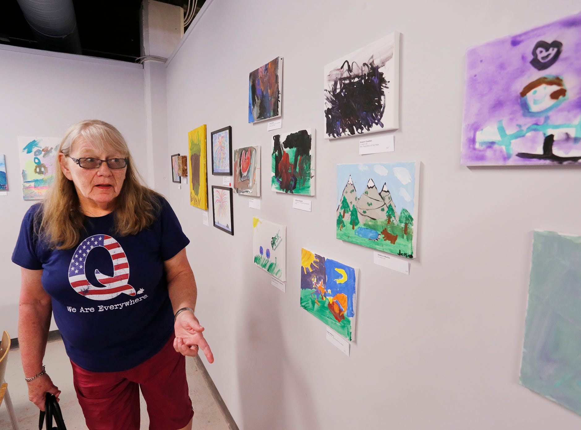 Shari Mikaelsson looks at an art exhibit to benefit Special Parents Special Kids Thursday, September 13, 2018, at Lala Gallery & Studio, 511 Ferry Street in downtown Lafayette. Mikaelsson's nephew, Kason Doeden, has a piece displayed in the exhibit.