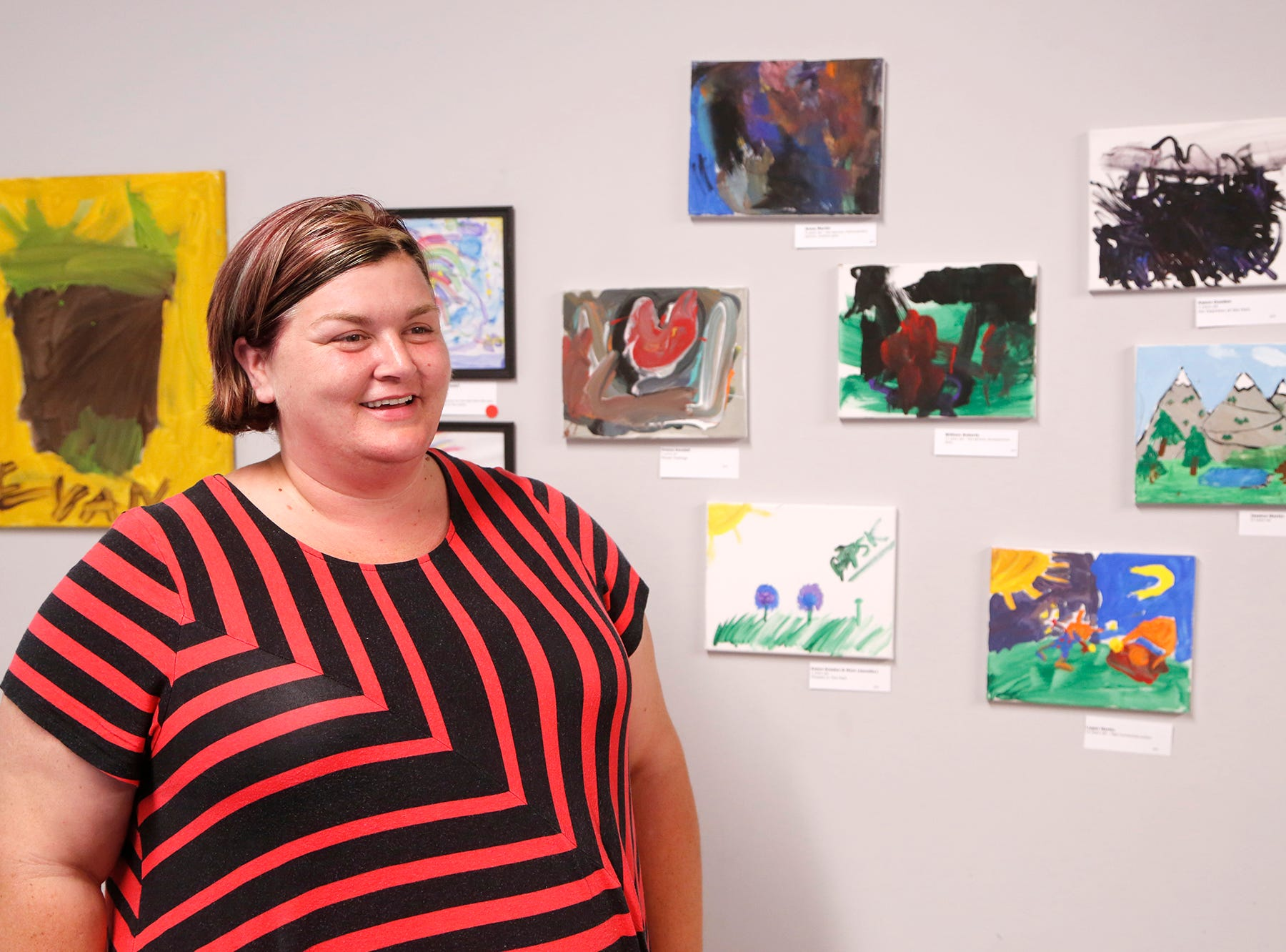 Tiffany Kendall greets guests at an art exhibit to benefit Special Parents Special Kids Thursday, September 13, 2018, at Lala Gallery & Studio, 511 Ferry Street in downtown Lafayette.