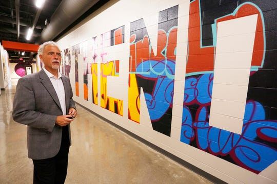 Steve Viars talks about the colorful murals that grace the halls inside the Northend Community Center Thursday, September 13, 2018, at 2000 Elwood Avenue in Lafayette. Viars, who is senior pastor at Faith Church, said local artist Zach Medler created the colorful murals. The Northend Community Center is the collaboration of 13 different nonprofits. The Northend Community Center will open at 3:30 p.m. Sunday, September 16.