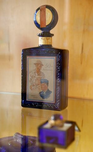 A whiskey bottle marking the 50th anniversary of the end of World War I is part of the Ohio Glass Museum's new show which features red, white and blue glass. The show opens Sept. 15 and runs until Feb. 28.