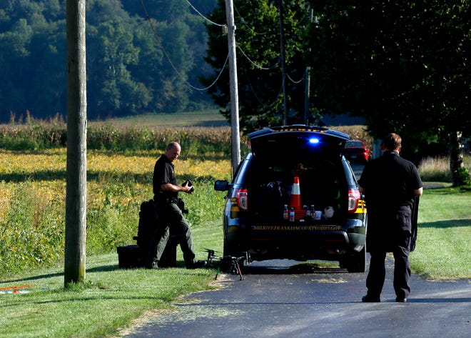 Franklin County Sheriff's deputies land a drone behind a cruiser Thursday night, Sept. 13, 2018, on Graceland Drive in Lancaster. Franklin County deputies were on Graceland Drive preparing for a large search for 66-year-old Theresa Shook on Friday. Shortly after the drone was in the air a body was located in the soy bean field east of Graceland Drive. Thursday night Lancaster police officers couldn't say if the body was Shook or not. Shook hasn't been seen since leaving her Graceland Drive apartment on Sept. 2.