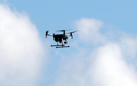 A drone flies over a soy bean field east of Graceland Drive Thursday, Sept. 13, 2018, in Lancaster.
