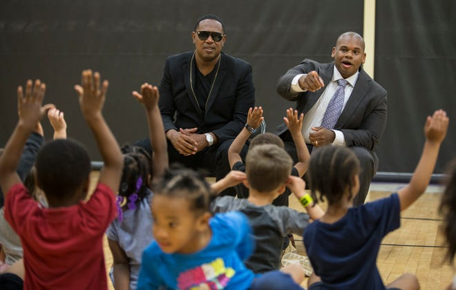 Dr. Wayne Lewis, Interim Commissioner of the Kentucky State Department of Education asked a question of preschoolers at the Chestnut Street YMCA. On left is rapper Master P. Sept. 14, 2018.
