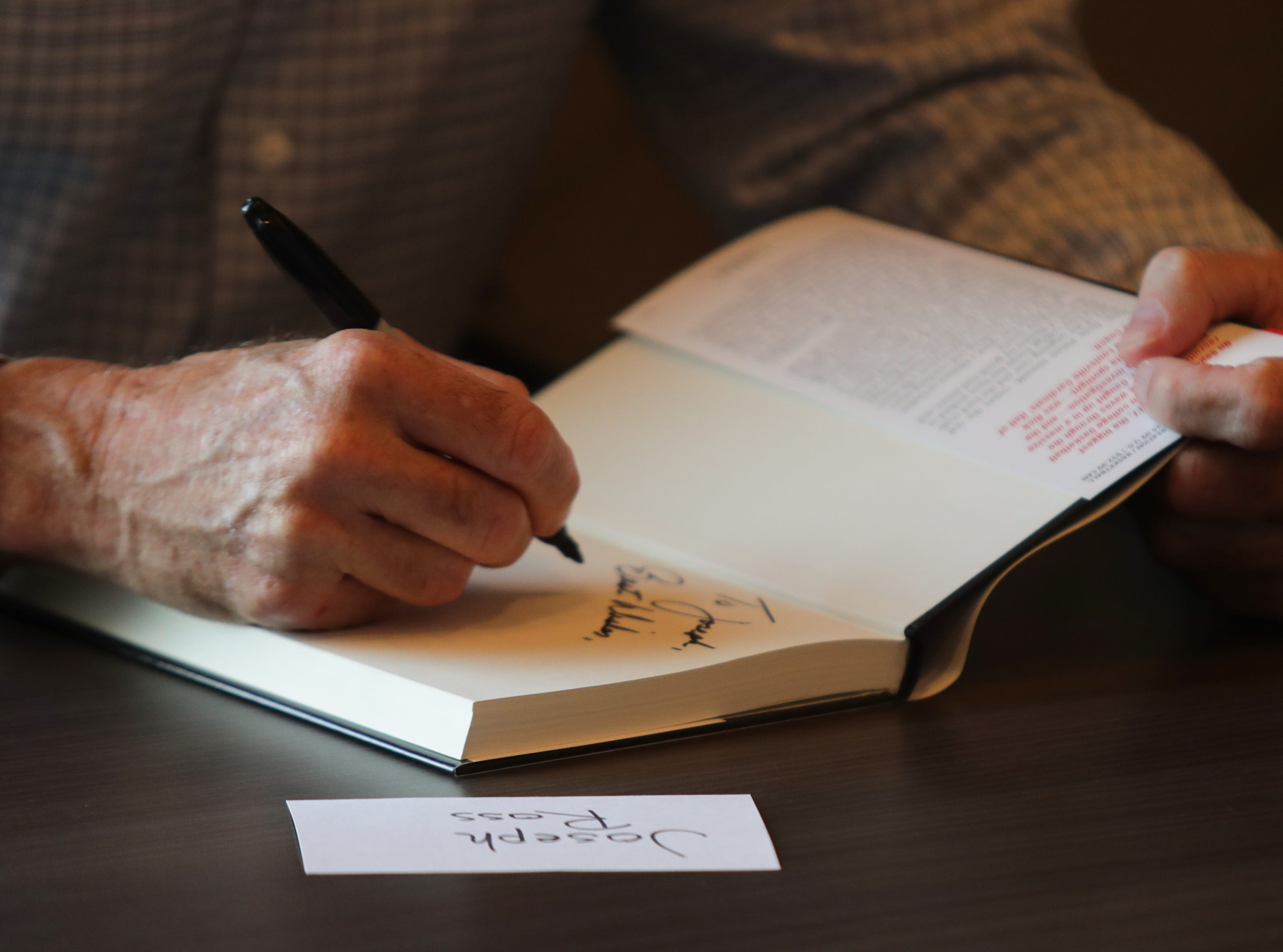 Rick Pitino signs his book at the Omni Hotel on Friday afternoon in Louisville, Kentucky.Sept. 14, 2018
