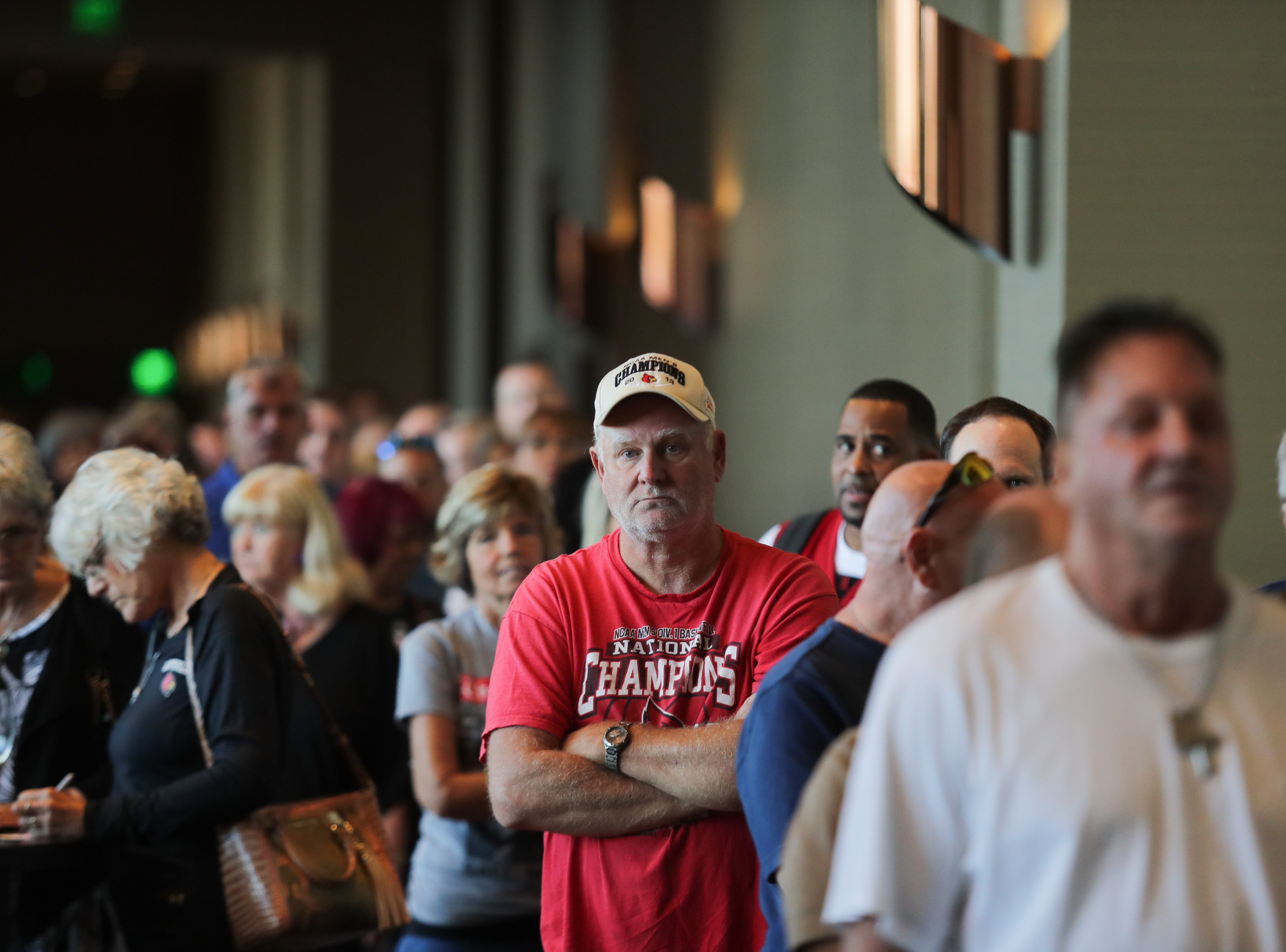 People wait in line for Rick Pitino's book signing at the Omni Hotel on Friday afternoon in Louisville, Kentucky.Sept. 14, 2018