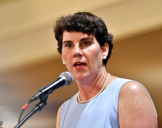 Amy McGrath, a Kentucky Democratic candidate for Congress, speaks to supporters during the 26th Annual Wendell Ford Dinner in Louisville on Aug. 18, 2018.