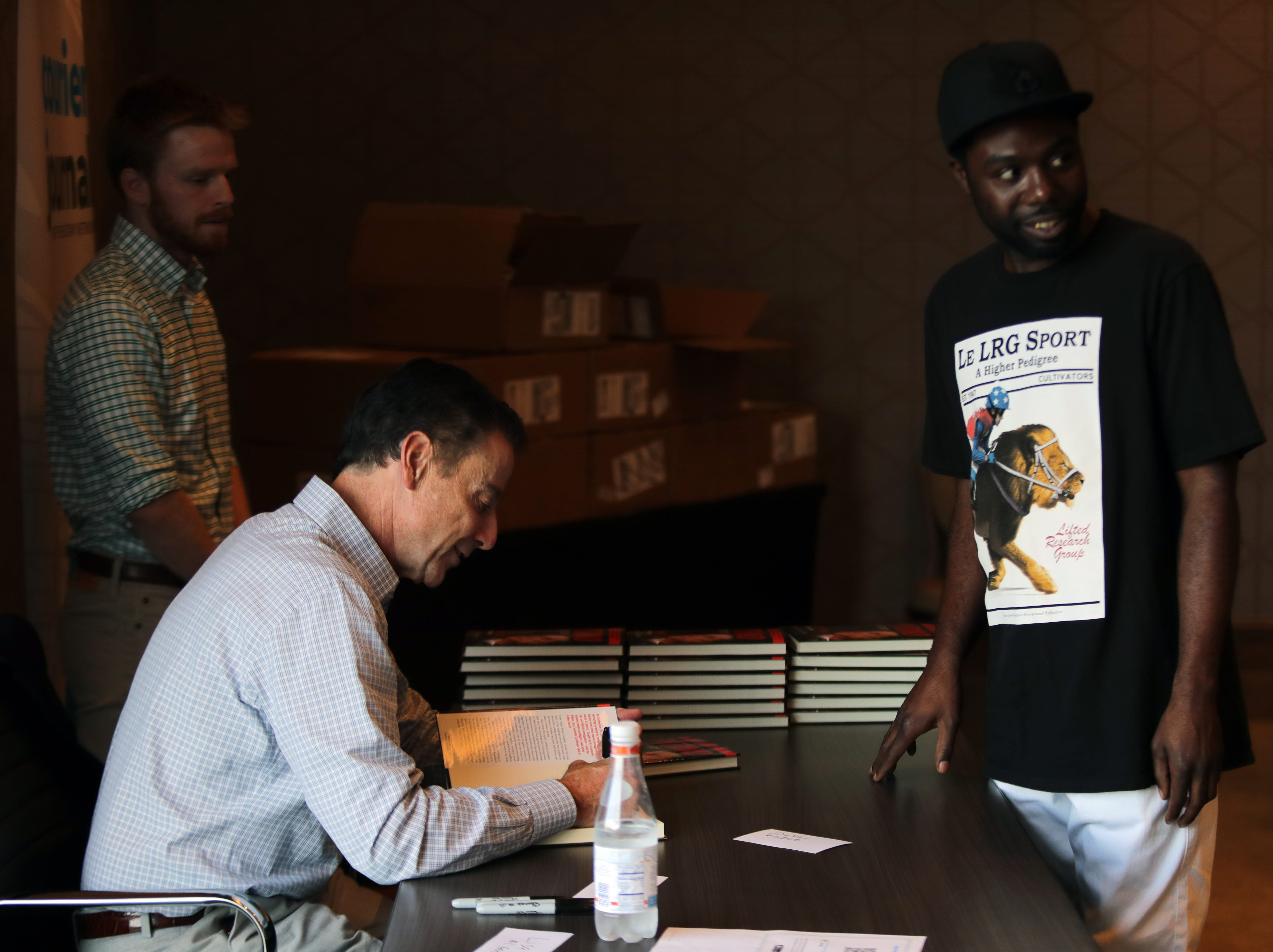 Rick Pitino talks with fans at his book signing at the Omni Hotel on Friday afternoon in Louisville, Kentucky.Sept. 14, 2018