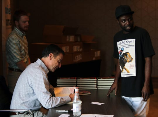 Rick Pitino talks with fans at his book signing at the Omni Hotel on Friday afternoon in Louisville, Kentucky.