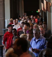 People wait in line for Rick Pitino's book signing at the Omni Hotel on Friday afternoon in Louisville, Kentucky.