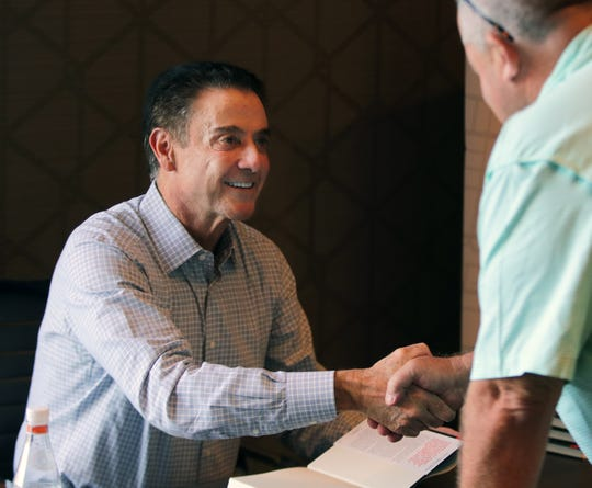 Rick Pitino shakes hands with a fan at his book signing event at Louisville's Omni Hotel on Sept. 14, 2018.