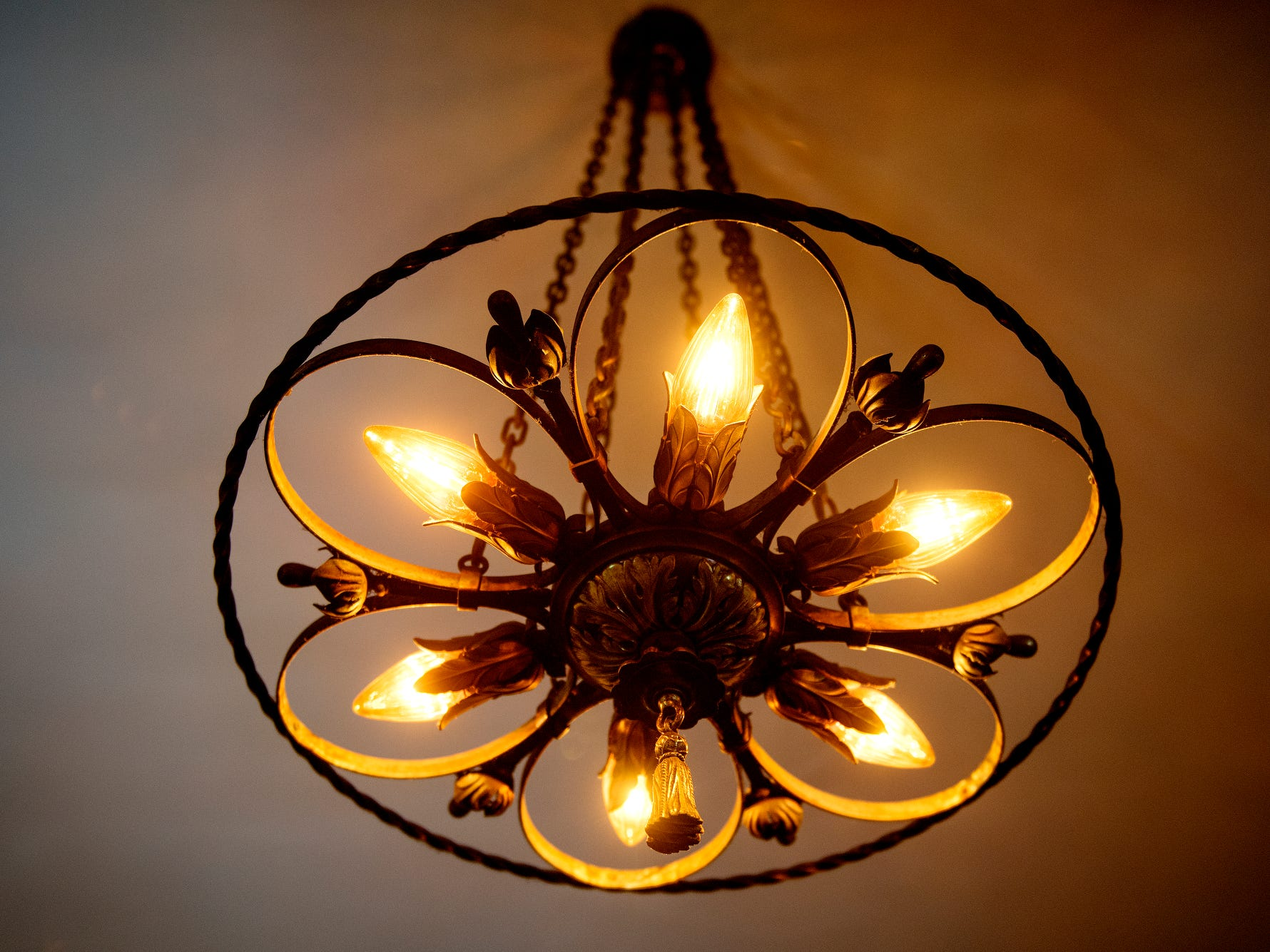 An original light fixture hangs inside the English Inn on Tuesday, Aug. 28, 2018, in Eaton Rapids.