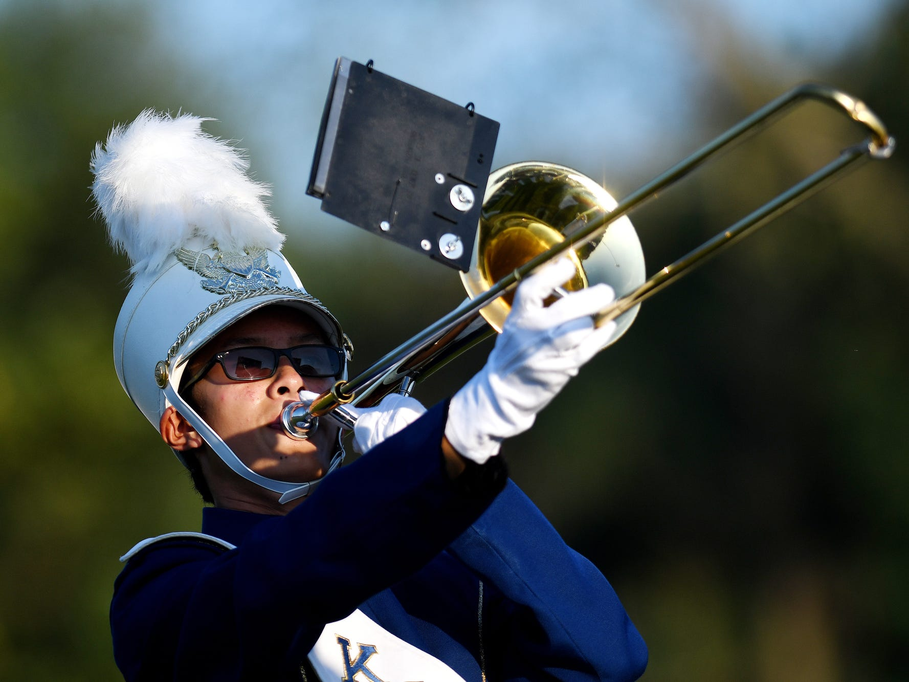 A member of the Haslett marching band performs with the group before the Vikings' football game against Fowlerville on Friday, Sept. 14, 2018, at Haslett High School.