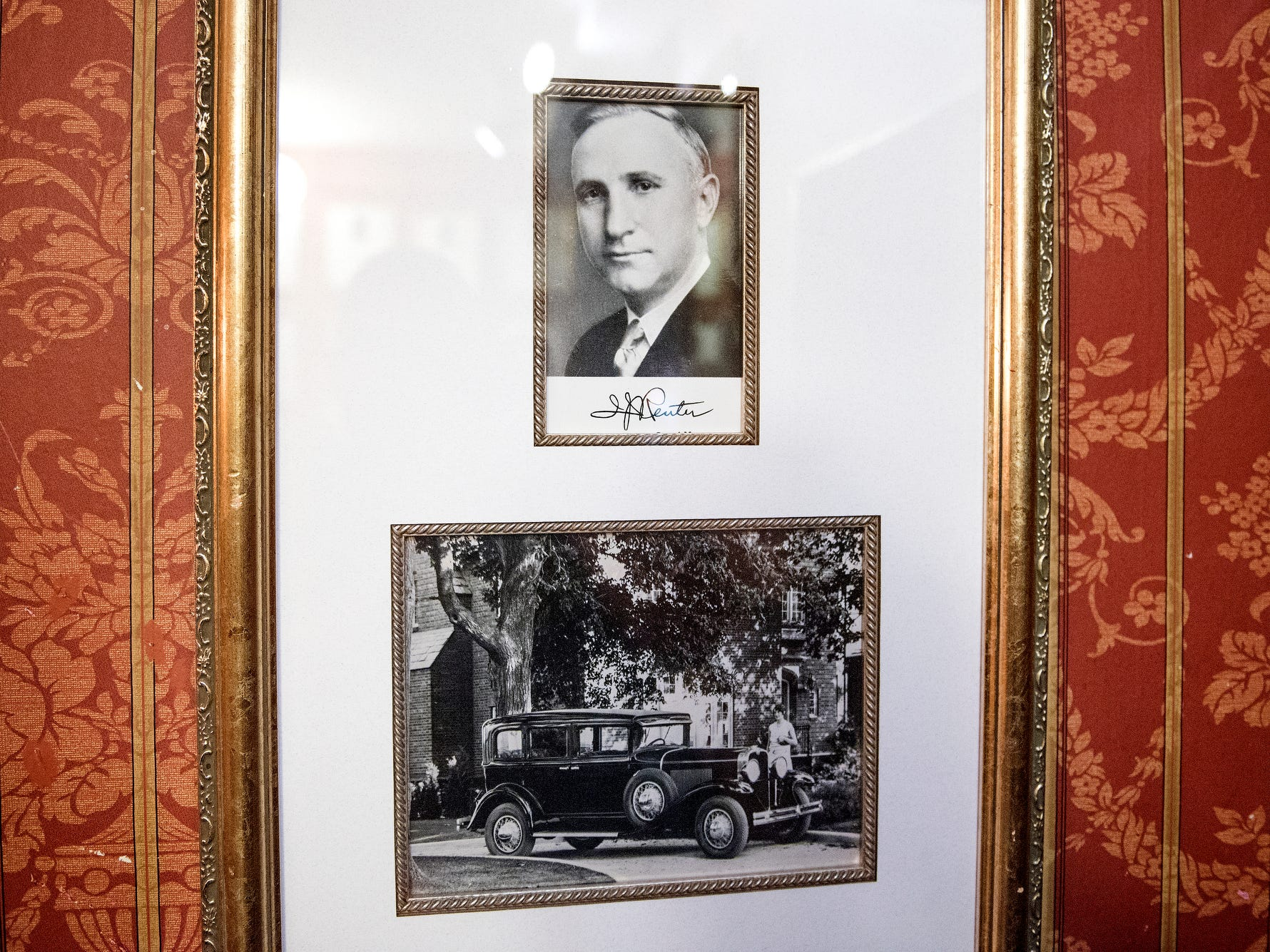 A portrait of original owner Irving Reuter and his wife Janet posed next to an Oldsmobile hangs in the garden level inside the English Inn on Tuesday, Aug. 28, 2018, in Eaton Rapids.
