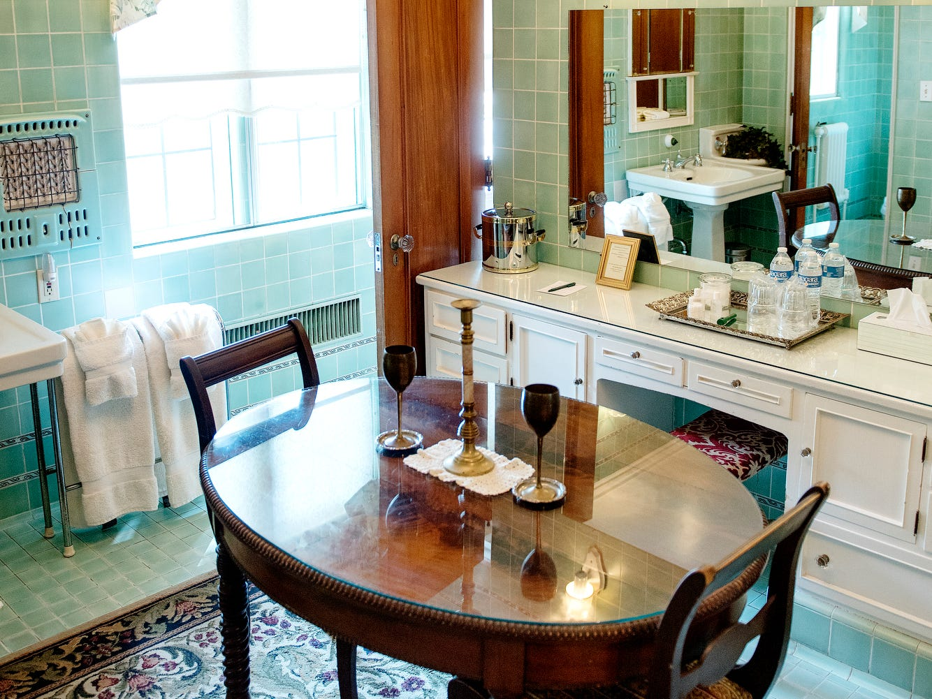 A table for two inside the Bath suite at the English Inn on Tuesday, Aug. 28, 2018, in Eaton Rapids. The 17-room mansion was once the home of Oldsmobile president Irving Reuter and his wife, Janet.