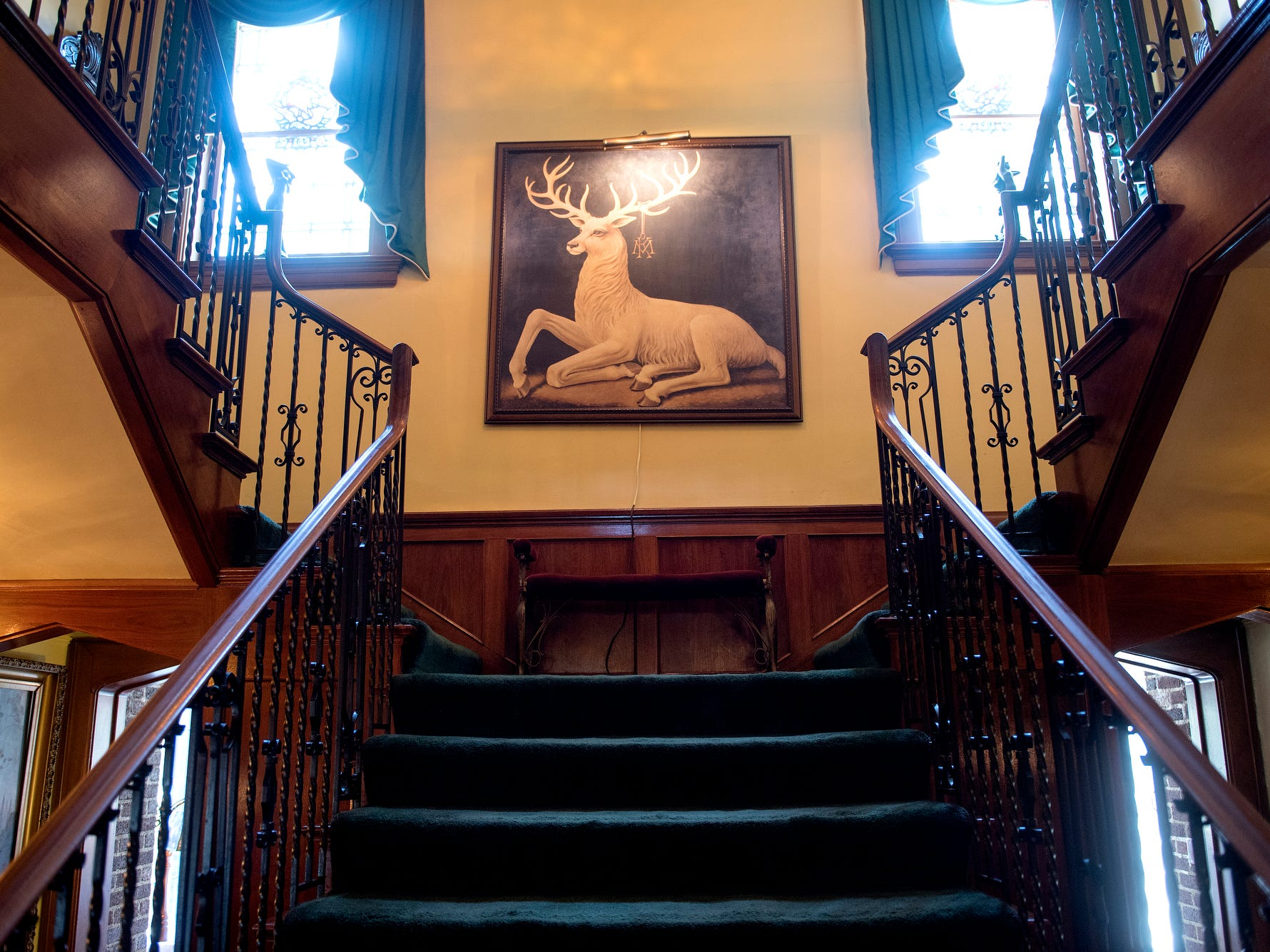 A large portrait of a buck deer hangs in the stairway at the English Inn on Tuesday, Aug. 28, 2018, in Eaton Rapids. The 17-room mansion was once the home of Oldsmobile president Irving Reuter and his wife, Janet.