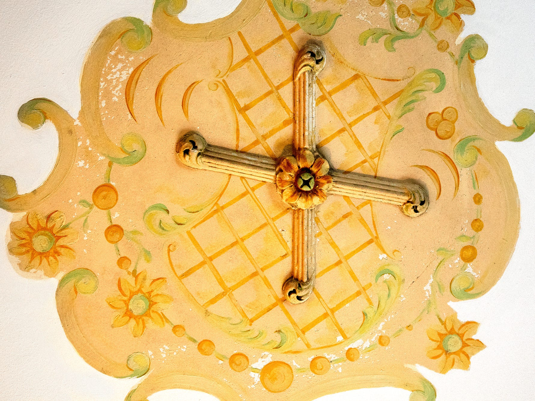 A decorative cross is displayed on the ceiling above the bed in the Bath suite at the English Inn on Tuesday, Aug. 28, 2018, in Eaton Rapids. The 17-room mansion was once the home of Oldsmobile president Irving Reuter and his wife, Janet.