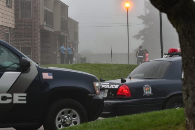 Members of the Lansing Police Department at the scene of a shooting early Friday morning, Aug. 14, 2018, at a south side apartment.