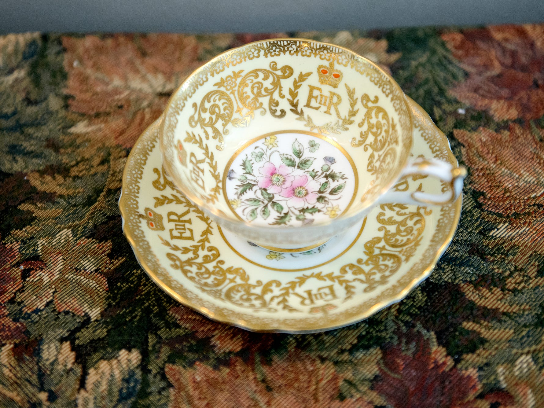 A Paragon tea cup and saucer set that commemorates Queen Elizabeth II's coronation is displayed inside the Windsor suite at the English Inn on Tuesday, Aug. 28, 2018, in Eaton Rapids. The 17-room mansion was once the home of Oldsmobile president Irving Reuter and his wife, Janet.