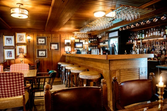A view of the bar inside the pub at the English Inn on Tuesday, Aug. 28, 2018, in Eaton Rapids. The 17-room mansion was once the home of Oldsmobile president Irving Reuter and his wife, Janet.