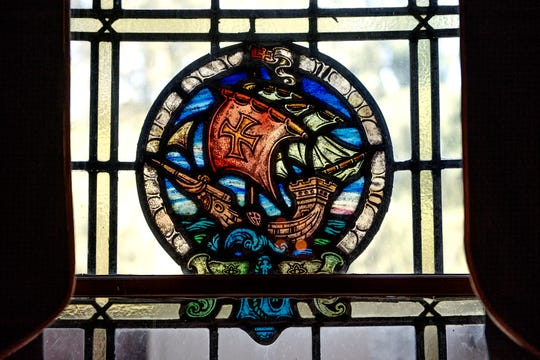 A stained glass window featuring the image of a ship at sea photographed at the English Inn on Tuesday, Aug. 28, 2018, in Eaton Rapids. The 17-room mansion was once the home of Oldsmobile president Irving Reuter and his wife, Janet.
