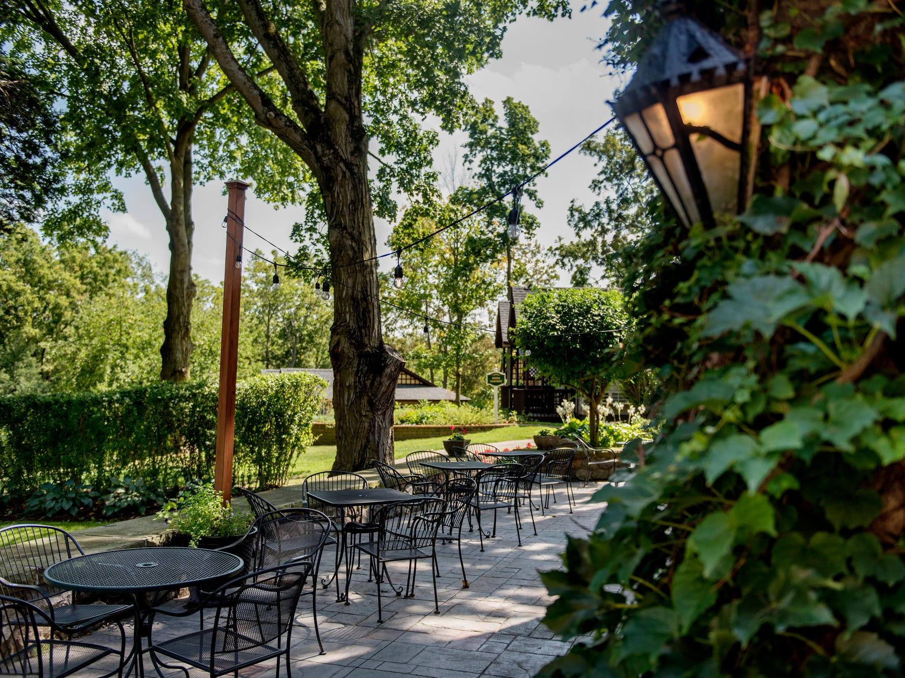 A view of the outdoor patio outside the pub on the garden level of the English Inn on Tuesday, Aug. 28, 2018, in Eaton Rapids. The 17-room mansion was once the home of Oldsmobile president Irving Reuter and his wife, Janet.