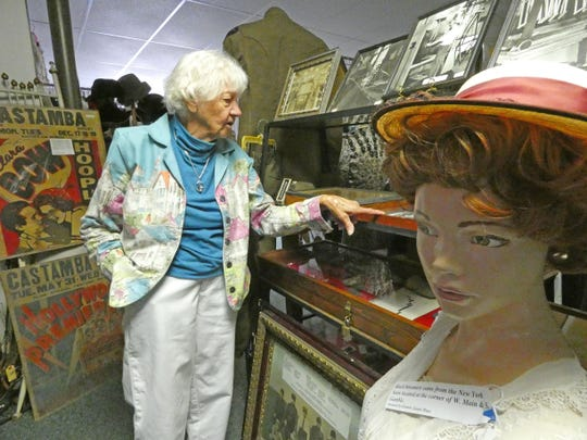 Sally Maier, curator at the Shelby Museum of History, talks about items in a display case Thursday afternoon.